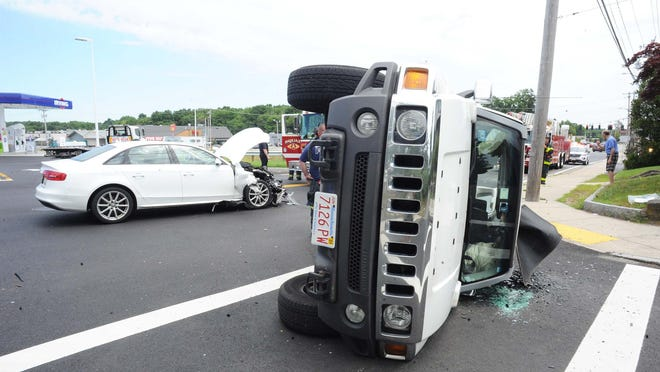 Police, firefighters investigate multi-vehicle rollover crash at 600-block of Pleasant Street in Brockton, on Friday, July 31, 2020.