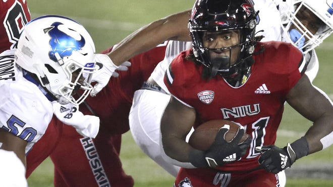 Northern Illinois running back Erin Collins carries the ball against Buffalo on Wednesday night in DeKalb, Ill.