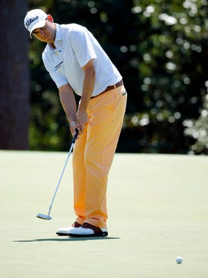 Bill Haas putts on the 14th green during the first round of the 2014 The Masters golf tournament at Augusta National Golf Club.