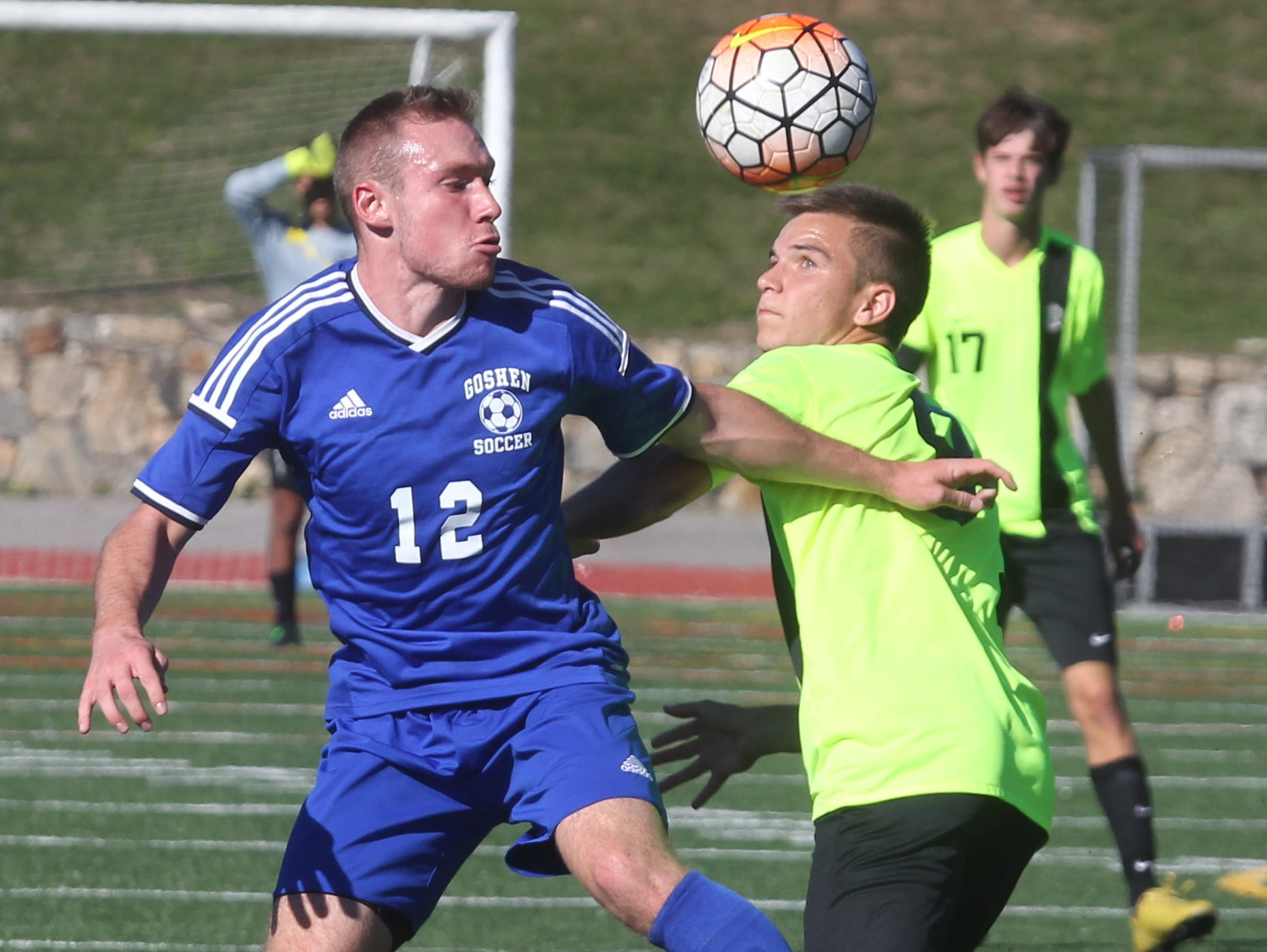 Goshen's Jakob Koppen, left, fights for the ball with Lakeland's Matias Prando during their Section 1 vs. Section 9 Challenge game at Valhalla Oct. 12, 2015. Goshen won 2-1 in overtime.