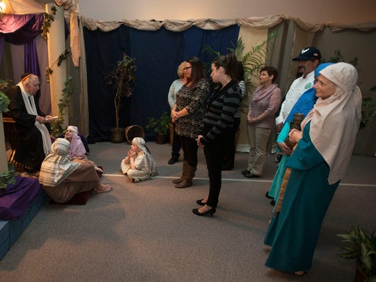 Volunteers from around the area play various towns people of the old Bethlehem during the time of Jesus' birth in the annual Return To Bethlehem at Groce United Methodist Church. The benefit is put on by the Asheville-Buncombe Community Christian Ministry.