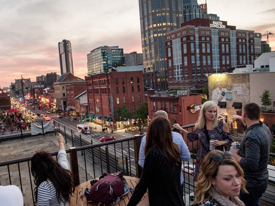Guests enjoy the view at the Acme Feed and Seed rooftop