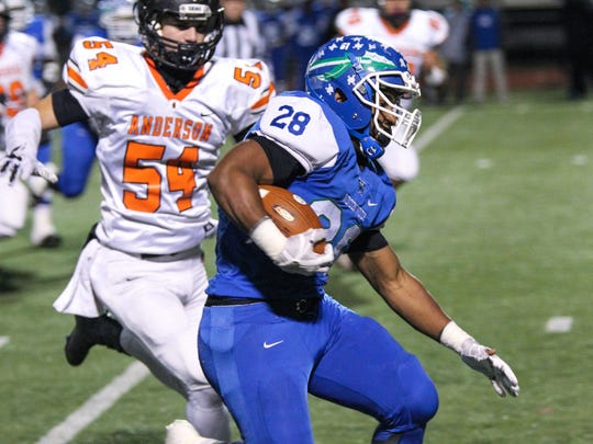 Winton Woods' Miyan Williams takes the ball down the field during the WInton Woods vs. Anderson football game at Lakota West on Friday Nov. 10, 2017.