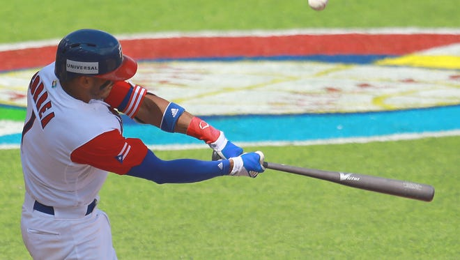 Puerto Rico's Carlos Correa connects for his second home run of the WBC.