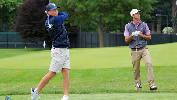 Grey Barnes watches Christian Cavaliere tee off during