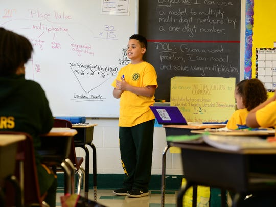 Andrew Ramos, a fourth-grader at the Paterson Academy for the Gifted and Talented at Public School No. 28, goes to the board to show his math formula to classmates.