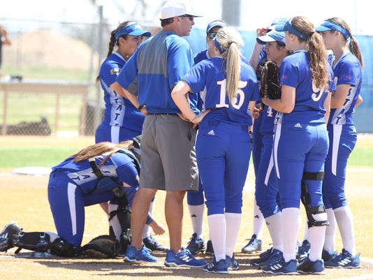 636580680669628222-Belles-Coach-Scott-and-players.JPG