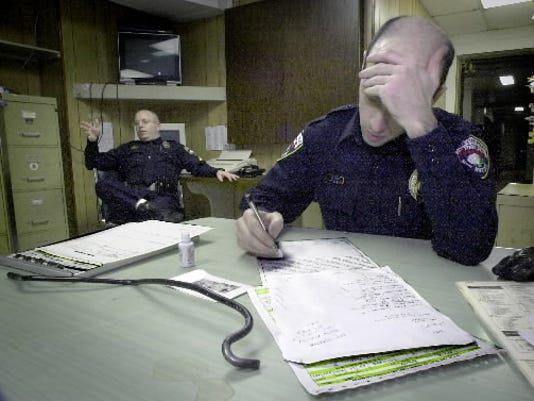 York City Police reporters go over information for a report. YORK DAILY RECORD/SUNDAY NEWS -- FILE PHOTO