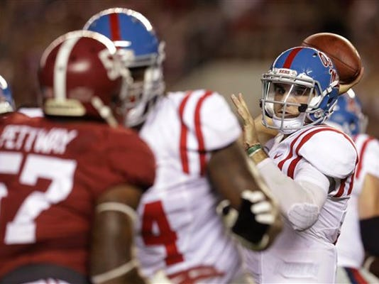 Mississippi quarterback Chad Kelly (10) passes the ball against Alabama on Saturday in Tuscaloosa, Alabama. The former Red Lion QB threw for 341 yards in the game.