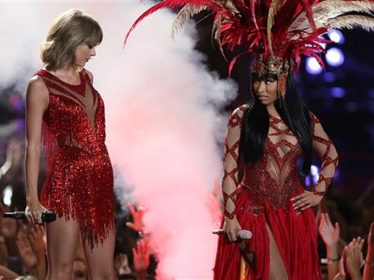 Taylor Swift, left, and Nicki Minaj perform at the MTV Video Music Awards at the Microsoft Theater on Sunday, Aug. 30, 2015, in Los Angeles.