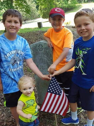 Fairview's Michael DeHart, Luke DeHart, Jacob Dehart, Peyton Walker help place flags on veteran graves in Ivey Cemetery over the Memorial Day Weekend.