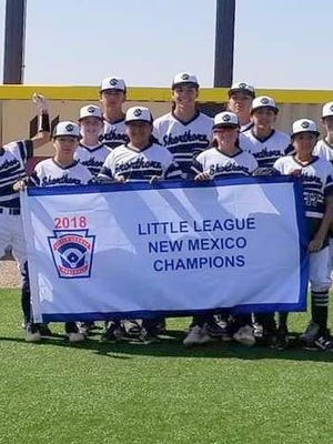 The Shorthorn Major team proudly displays its championship banner with a win over Lions Hondo on Sunday. Shorthorn advances to the Regional division of the Little League World Series in Waco, Texas. Shorthorn will represent New Mexico and face Okalahoma Aug. 2 at 1 p.m. in the second game of the tournament.