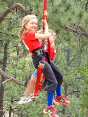 No fear on this young rider's face as she challenges the zipline in midtown Ruidoso.