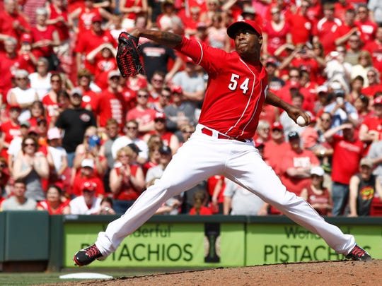 Cincinnati Reds relief pitcher Aroldis Chapman throws against the Colorado Rockies in the ninth inning at Great American Ball Park, May 11, 2014.