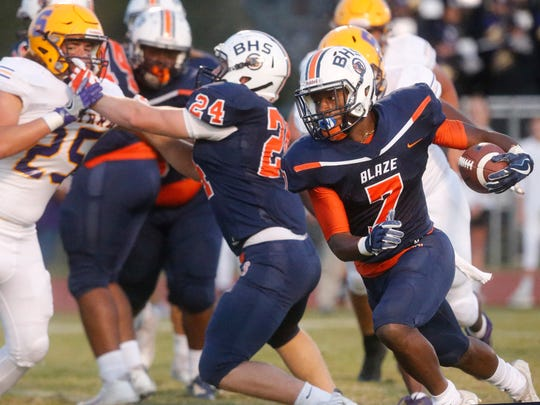 Blackman's Cordel Braxton (7) runs the ball during the game against Smyrna, on Friday, Sept. 8, 2017, at Blackman.