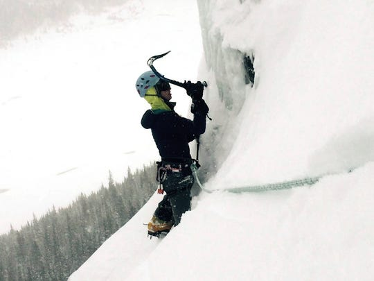 First Lieutenant Elyse Ping Medvigy ice climbing on