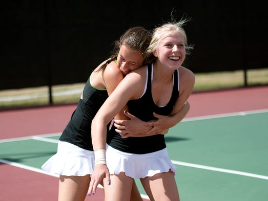 Fossil Ridge's Emma Jo Wiley, left, hugs Kaitlyn Motley after she won her No. 2 singles match against Cherry Creek's Julia Mannino at the State Tennis Championships at Gates Tennis Center in Denver Saturday, May 10, 2014.