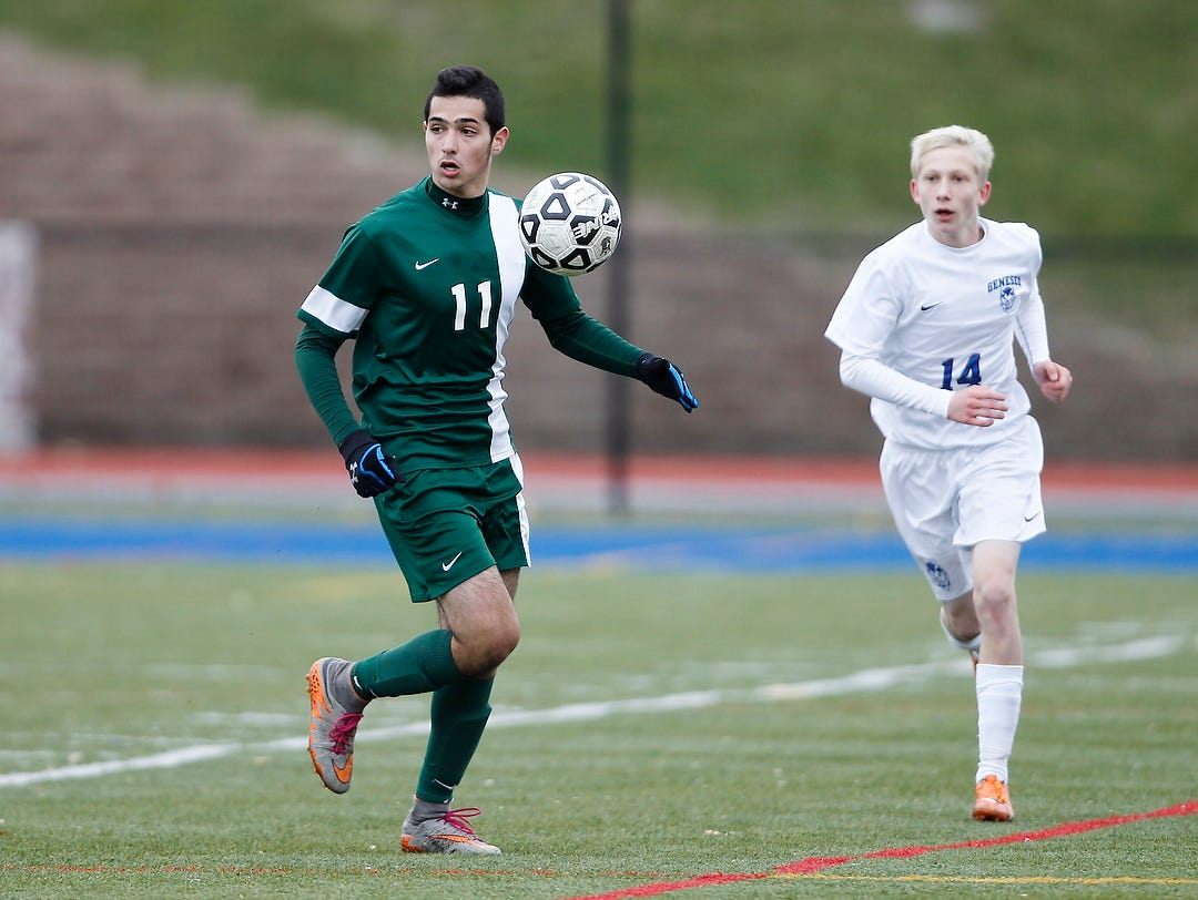 Solomon Schechter's Jonathan Rand (11) controls the ball during their 1-0 win over Geneseo in the NYSPHSAA Class C state semifinal soccer game at Middletown High School on Saturday, Nov. 14, 2015.
