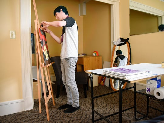 Alex Crandall shows some of his art Tuesday, May 17,