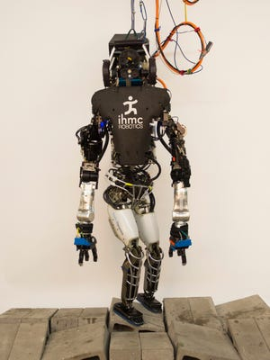The 6-foot-tall Atlas robot, built by Boston Dynamics but with the all-important controlling software designed by IHMC researchers.