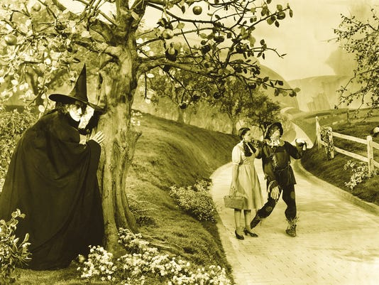 "From left, Margaret Hamilton, Judy Garland and Ray Bolger starred in ""The Wizard of Oz."" Photo courtesy of Scarfone/Stillman Collection. and appearing in ""The Wizard of Oz: The Official 75th Anniversary Companion"" by William Stillman and Jay Scarfone, published by Harper Design, an imprint of HarperCollins Publishers; © 2013 by Author. Copyright © 2013 Turner Entertainment Co. � THE WIZARD OF OZ and all related characters and elements are trademarks of  © Turner Entertainment Co."