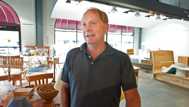 Dwight Sargent, owner of Pompanoosuc Mills, surveys the furniture store's new location on Market Street in South Burlington on Friday. The store, which was on Church Street in Burlington for many years, will hold a grand opening Saturday.