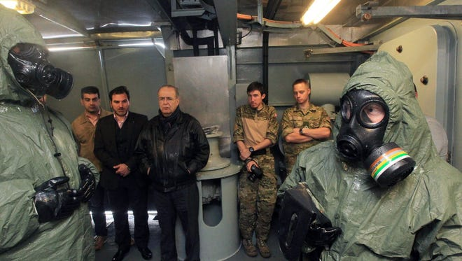 Cypriot Foreign Minister Ioannis Kasoulides, center, visits the Danish support vessel L17 Esbern Snare, one of the vessels deployed to bring Syria's chemical agents to destruction, in Larnaca, Cyprus, on Feb. 3.