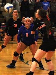 Garden City's Holly Sayger passes the ball as teammates
