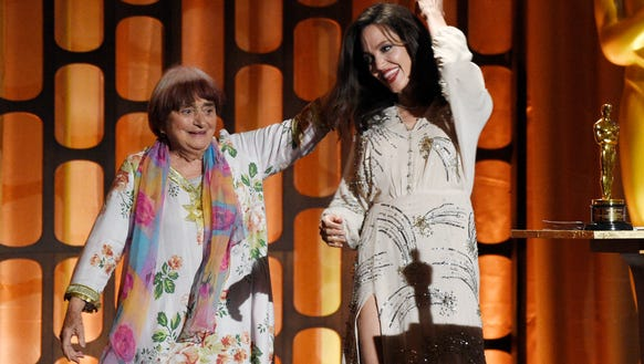 French film director Agnes Varda, left, dances onstage