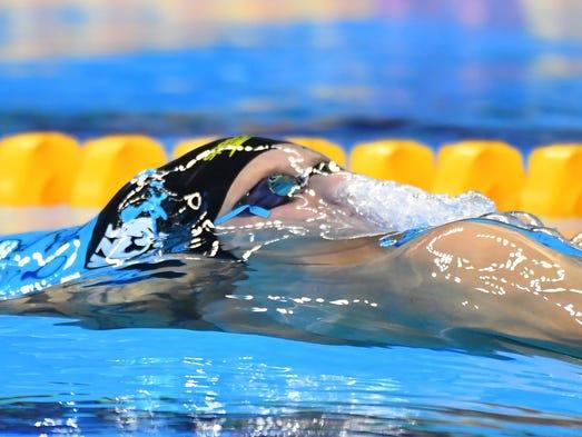 Corey Main (NZL) during the men's 100m backstroke heats.