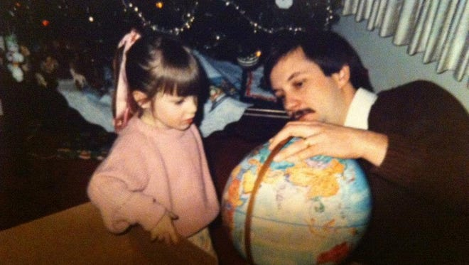 Ron Novosel shows young Kimberly the world.