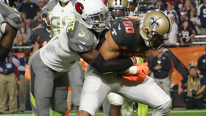 Team Irvin tight end Jimmy Graham of the New Orleans Saints catches a touchdown pass while defended by Team Carter cornerback Antonio Cromartie of the Arizona Cardinals during the fourth quarter of the Pro Bowl at University of Phoenix Stadium in Glendale on Jan. 25, 2015.