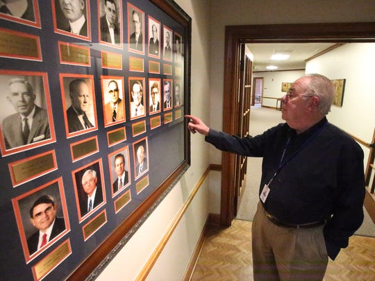 Tom Shockley, El Paso Electric CEO looks at portraits of past company CEO's at the company's headquarters at 100 N. Stanton in Downtown El Paso.