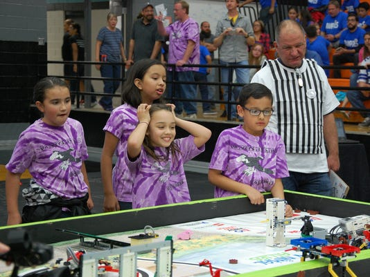 Students demonstrate robotics skills in FIRST LEGO League