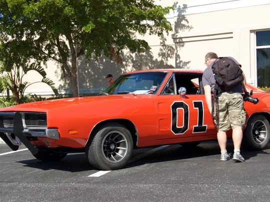 """This replica of the General Lee from """"The Dukes of Hazzard"""" was parked outside of the SW-Florida Comic-Con."""