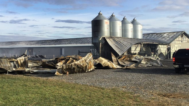 One chicken house burned down, and a second was severely damaged in a fire that occurred Sunday morning in Heidelberg Township. The cause of the fire is still under investigation.