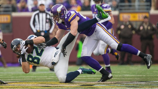 Minnesota Vikings safety Harrison Smith (22) tackles Seattle Seahawks tight end Luke Willson (82) during the first quarter at TCF Bank Stadium.