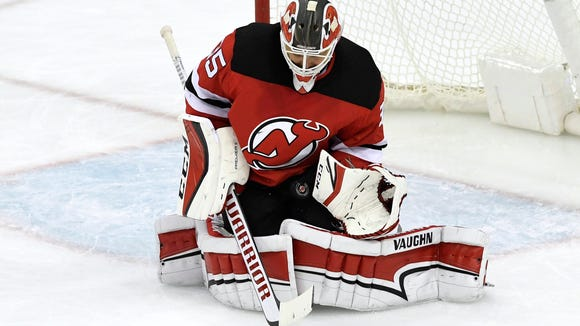 New Jersey Devils goaltender Cory Schneider (35) makes a save against the Red Wings. The Detroit Red Wings defeat the New Jersey Devils 3-0 in Newark, NJ on Monday, January 22, 2018.
