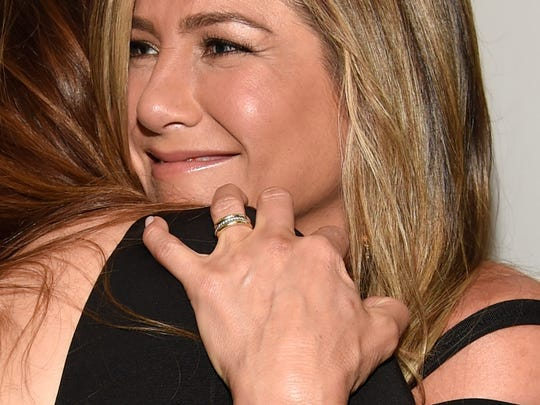 "Jennifer Aniston, right, hugs Kathryn Hahn as they arrive at the Los Angeles premiere of ""She's Funny That Way"" at the Harmony Gold theater on Wednesday, Aug. 19, 2015."