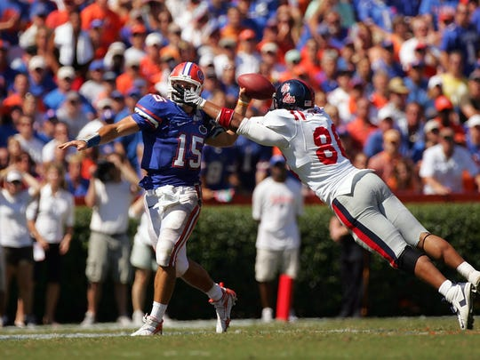 In this 2008 file photo, Ole Miss' Greg Hardy pressures Florida quarterback Tim Tebow during the Rebels' upset victory over the Gators.