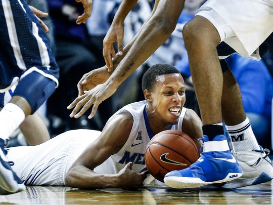 University of Memphis forward Jimario Rivers grabs a loose ball during second-half action against Monmouth University at FedExForum.
