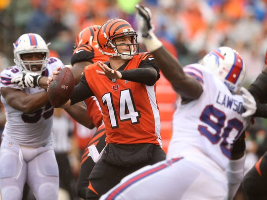 Cincinnati Bengals quarterback Andy Dalton (14) drops back to throw as the offensive line pass protects in the second quarter during the Week 5 NFL game between the Buffalo Bills and the Cincinnati Bengals, Sunday, Oct. 8, 2017, at Paul Brown Stadium in CIncinnati.