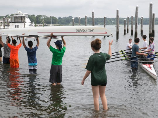 People enjoy the Navesink River for recreation but levels of bacteria in the river have been rising according to a recent study. Teens from the Navesink River Rowing Club get their boats ready on July 1, 2016 in Red Bank.