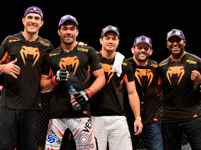Lyoto Machida, second from left, and his team celebrate after his unanimous-decision victory over Gegard Mousasi in the main event at UFC Fight Night 36 in Jaragua do Sul, Brazil.