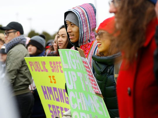 """Protesters hold signs during a youth-led rally """"A Hate"""