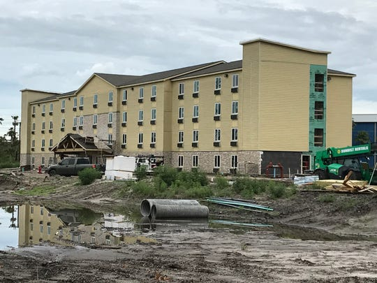 A Woodspring Suites Melbourne is nearing completion just east of Interstate 95 off of West New Haven Avenue in West Melbourne. The site is where County Line Saloon was previously located, just off of Dike Road.