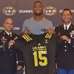 Martez Ivey accepts his U.S. Army All-American Bowl jersey.
