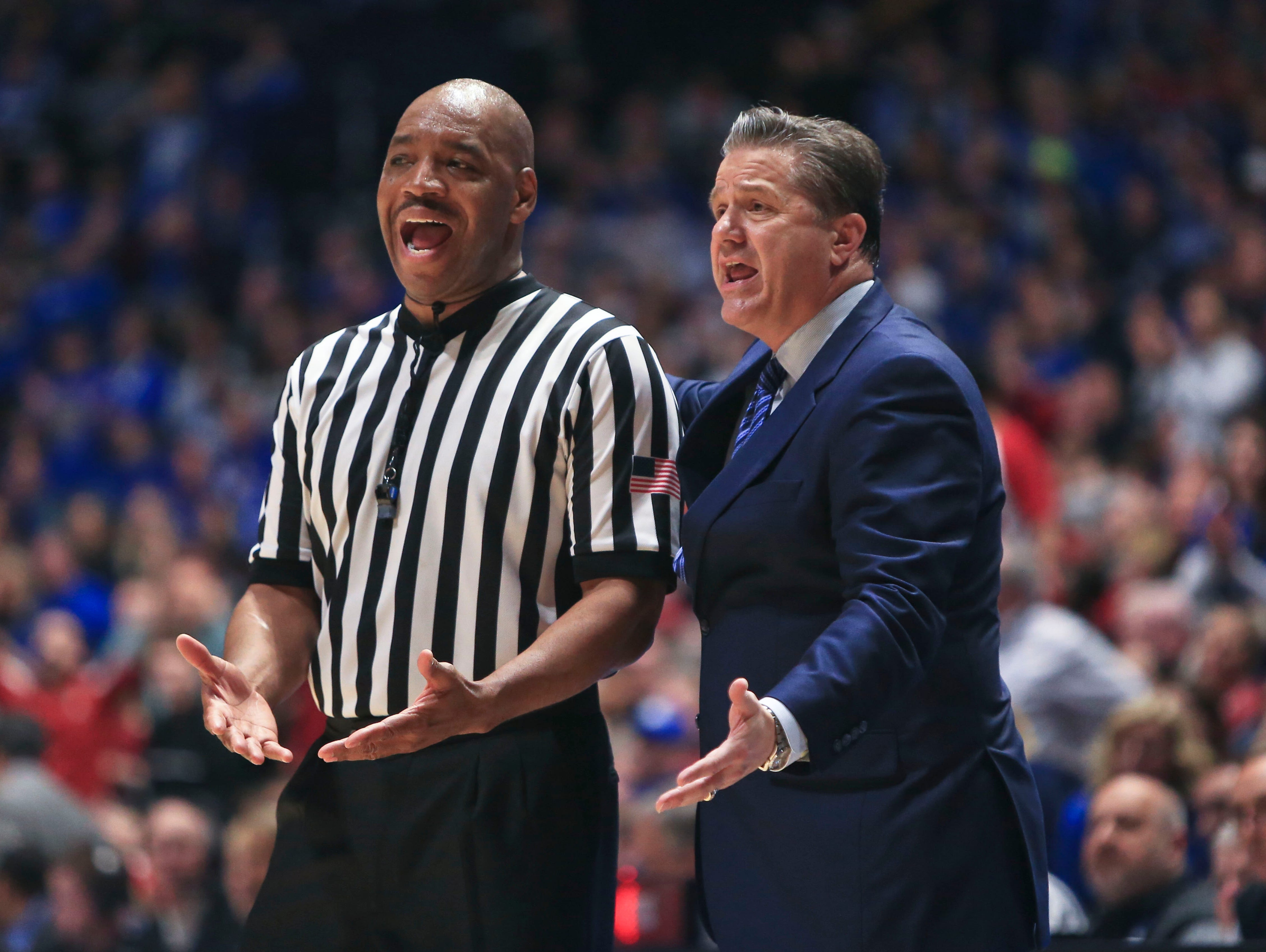"""Kentucky's John Calipari gives an official an earful in the second half against Alabama. """"The team is starting to come together and understand, you know, numbers don't matter on a team like this,"""" Calipari said afterwards to the media."""