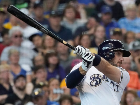 Milwaukee Brewers' Travis Shaw hits an RBI double during the fifth inning of a baseball game against the Pittsburgh Pirates Thursday, June 22, 2017, in Milwaukee. (AP Photo/Morry Gash)