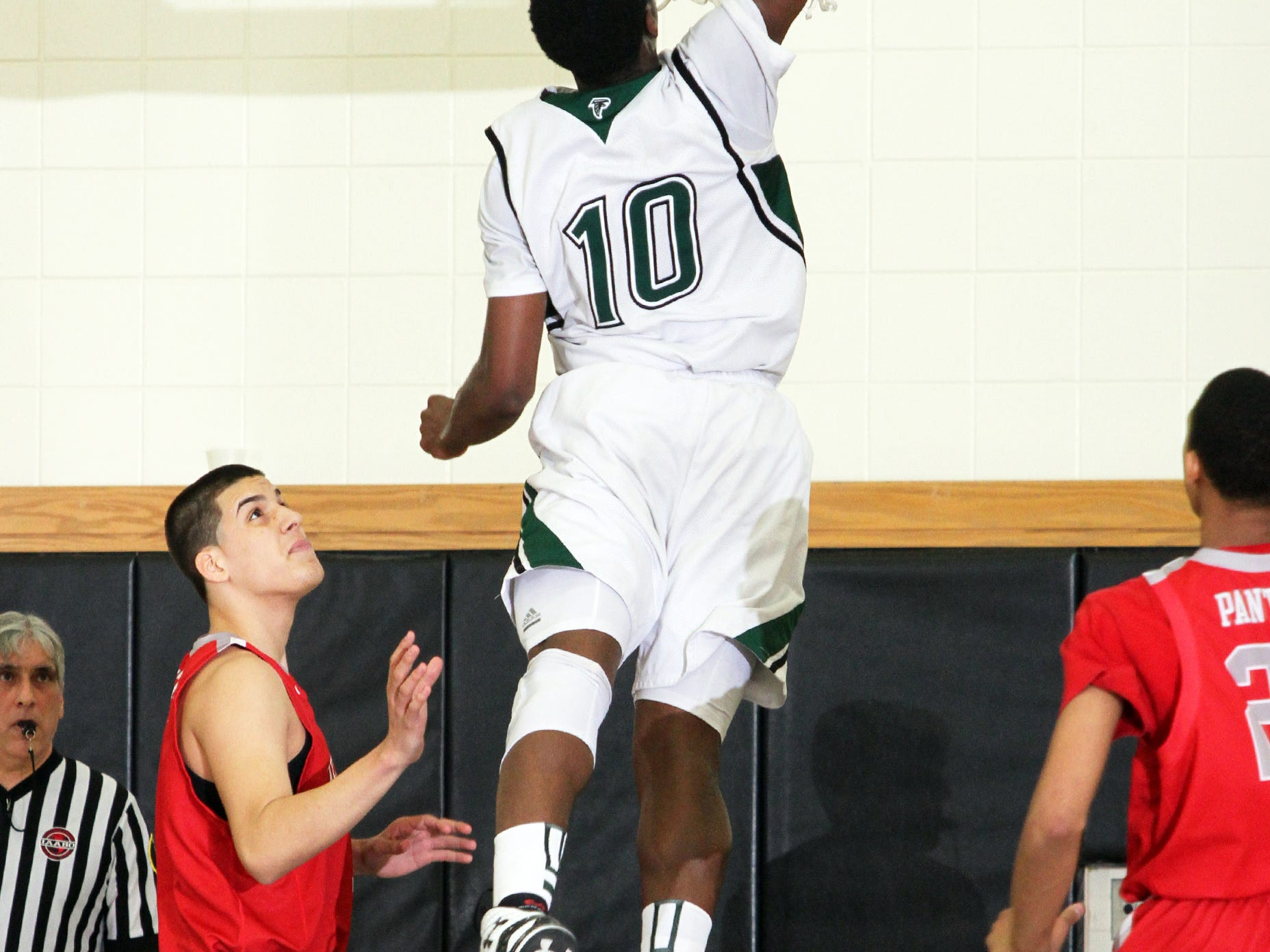 2015 Boys GMC basketball semi finals held at South Brunswick high school in South Brunswick on Tuesday February 24,2015. Perth Amboy takes on St. Joseph's of Metuchen. Here St. Joseph's # 10- Marcus Ashamole goes for the put back dunk during the 1st half of play.